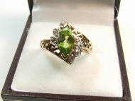 9ct Gold Peridot and Gem Ring.